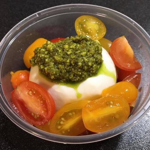 Fresh Mozzarella with tomatoes and pesto