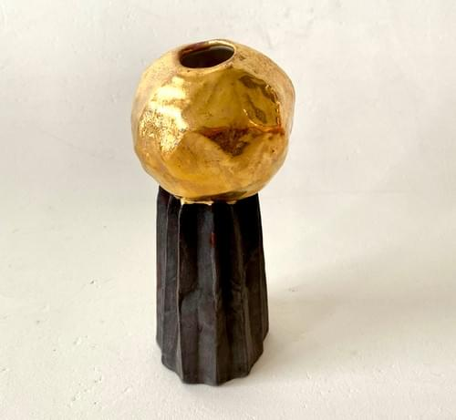 Gold sphere on folded charcoal base