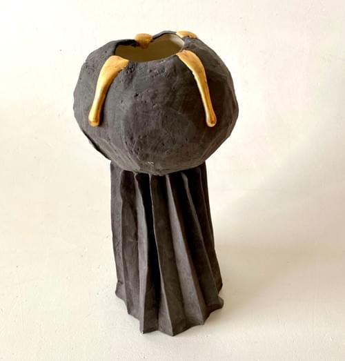 Charcoal dome on folded base with gold drips