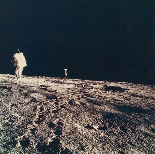 Alan Bean walking in front of the camera lens in the center, Apollo 12, November 1969