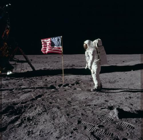 Astronaut Edwin 'Buzz' Aldrin poses by the U.S. flag on the moon's Sea of Tranquility.