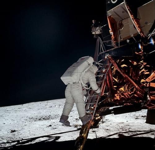 Apollo 11 photograph of Aldrin climbs down
