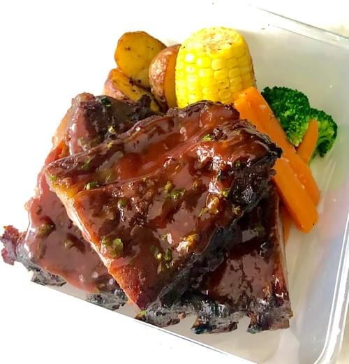 Oven-Baked Ribs of Hormone-Free Pork topped with Smoky BBQ Sauce with hints of spices