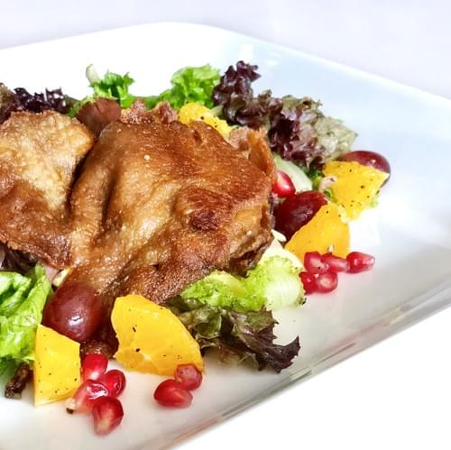 Confit Leg of French Duck, Greens, Vinaigrette of Calamansi
