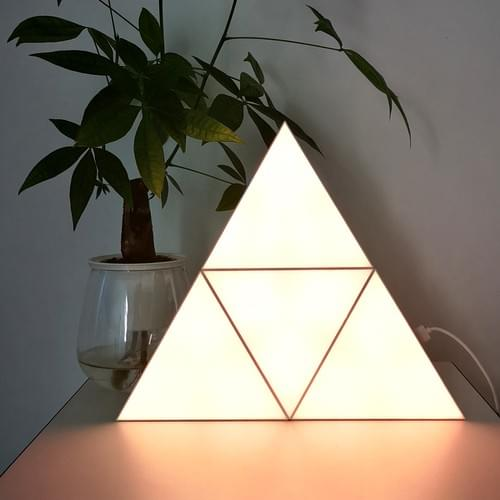 Remote controlled triangle lights for gaming room setups
