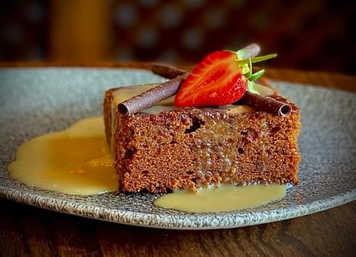 Classic Slow Baked Sticky Toffee Pudding with our Special Toffee Sauce, Rich Chocolate Sauce, Whippe