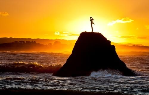 Bronze statue of Wairaka on a rock at the Whakatane Heads.