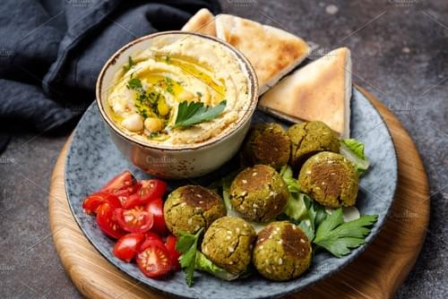 Falafels, Hummus, and pita ( half pan (12-16)
