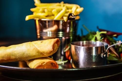 Flash Fried Golden Vegetable Spring rolls, Sweet Chilli Dipping Sauce, Seasonal Salad & Fries