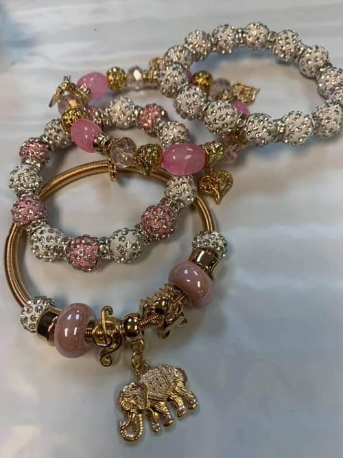 PINK AND GOLD CHARM BRACLET