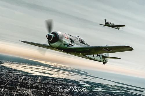 FW190 pair climbing out to intercept Allied bombers