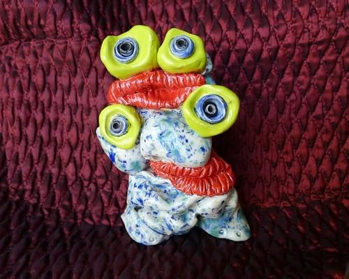 Two Headed Monster Two Sets of Eyes and Lips and is One of a Kind Hand Built Studio Pottery