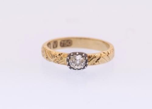 Single stone ring with old mine diamond