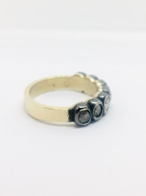 A gold and silver half etrnity ring with diamonds
