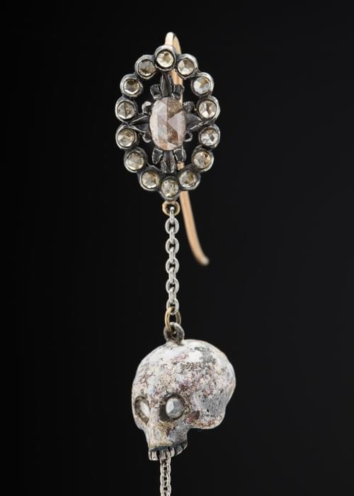A pair of enameled skull earrings