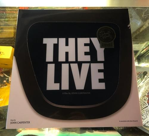 John Carpenter's THEY LIVE LP On Vinyl In Die-cut Gate Fold Sleeve!