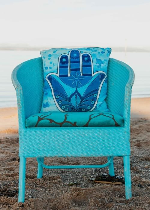 Handmade velvet cushion 'Blue Hamsa' designed by Beach Bird