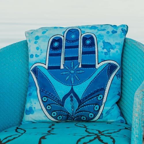 Handmade velvet cushion 'Blue Hamsa' designed by Beach Bird