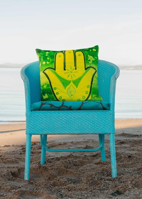 Handmade velvet cushion 'Yellow Hamsa' designed by Beach Bird
