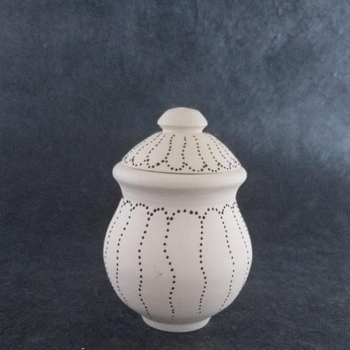 Lidded clay pot with delicate pattern of black raised dots