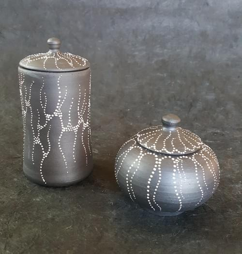 Black clay, lidded pot with white dots design