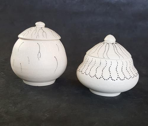 White lidded pots