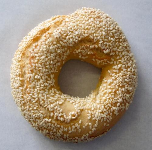Sesame bagel with spreads