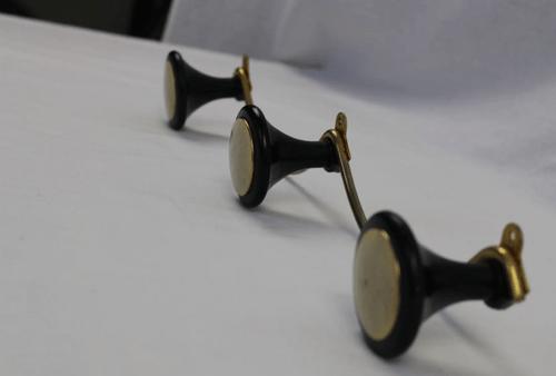 Patère moustache dorée