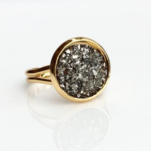 Flat rocky grey gold ring