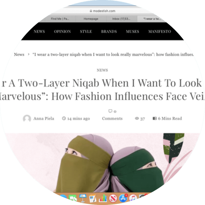 screenshot of the article with a photo of two women in single layer face veils