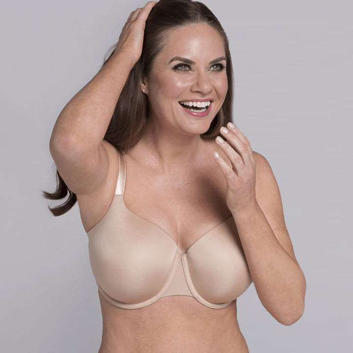 Laughing lady with light nude bra