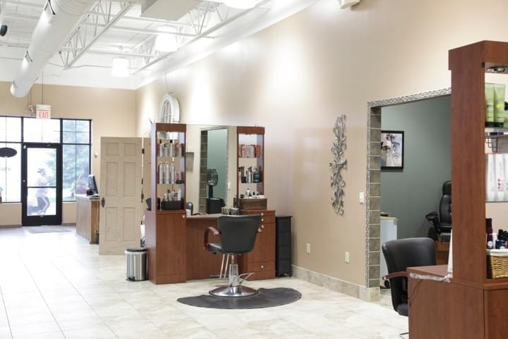 Two-sided hair stations and the high, bright ceiling at Tranquility Spa Salon in Brooklyn Park, MN