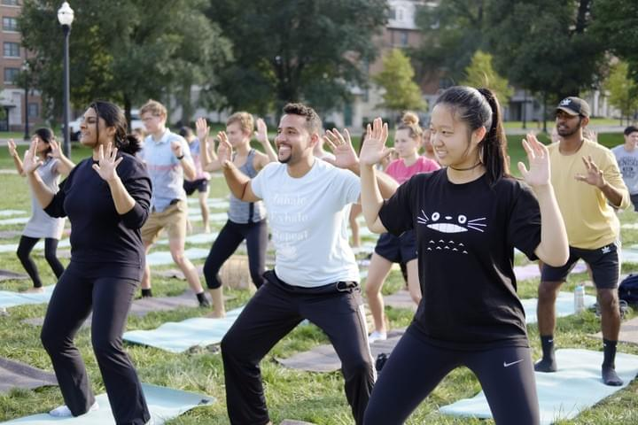 students doing yoga on the South Oval at The Ohio State University (OSU)