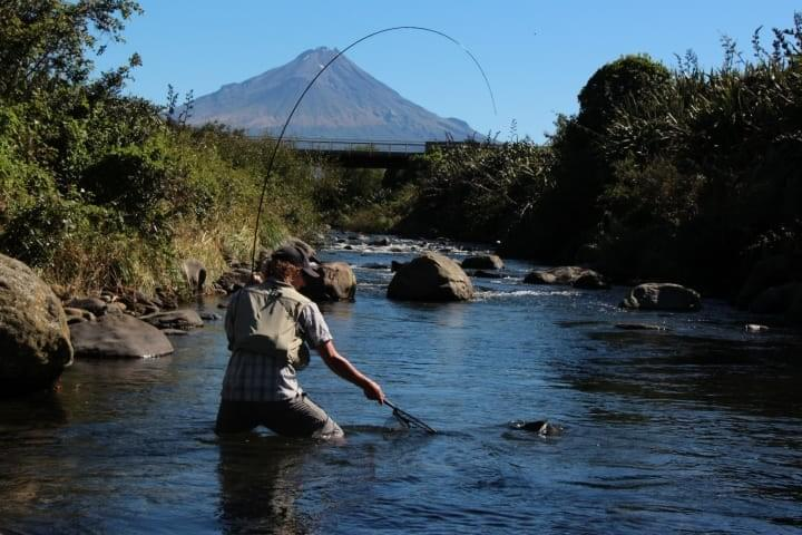 Nice bend on rod with Mount Taranaki in background