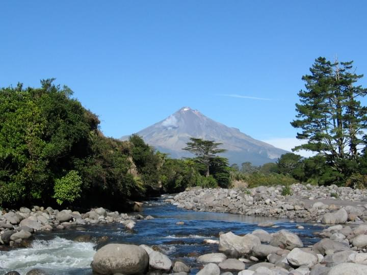 Clear trout waters under dormant volcano Mount Taranaki