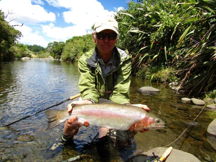 George Sinelnik displays his  Taranaki  small stream 5.5lb rainbow before releasing, this fish  fought hard and jumped many times!