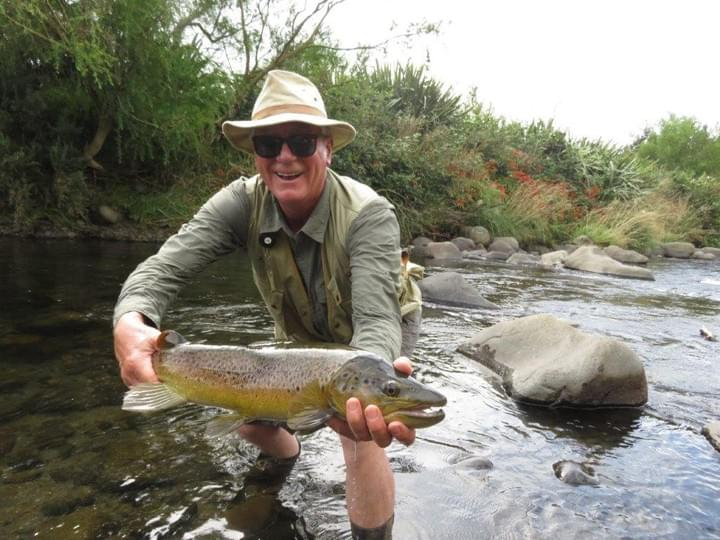 Another small stream, another big fish. Happy angler Gerard Gervaise shows  off his 5.5lb brown trout before releasing