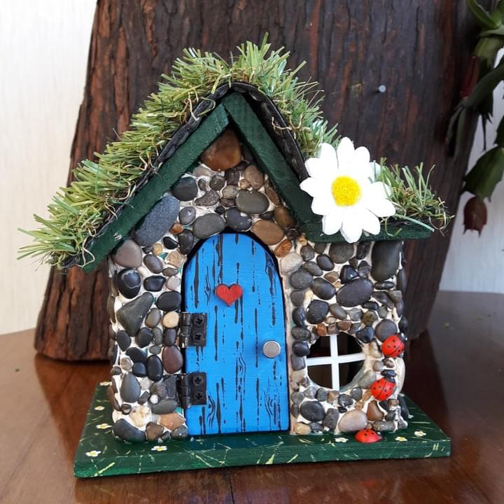 Stone fairy house with miniature furniture