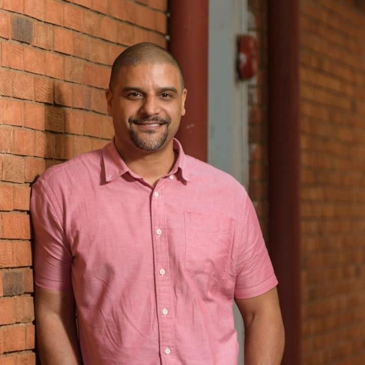 aidx co-founder Tarig Hilal standing in front of a brick wall in Nairobi, Kenya