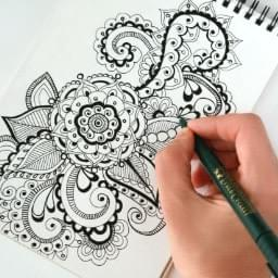 hand drawing a creative design showing how creativity is revitalized when distractions go away