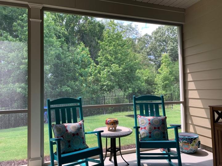 Screened Room with Blue Rocking Chairs
