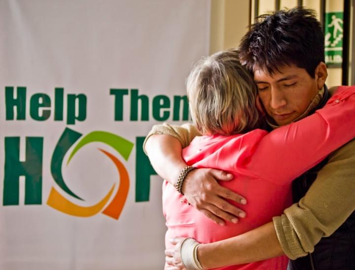 HOPE Scholarship Recipient  receiving a hug