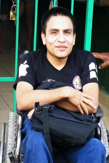 Juan Daniel, in his wheelchair at his school