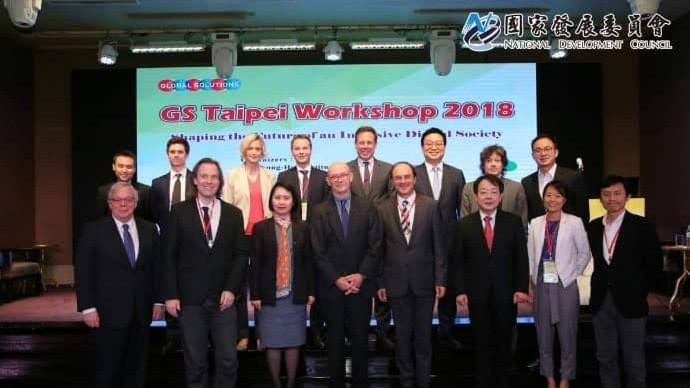 Julia Suh is standing with other speakers at the Global Solutions Taipei Workshop