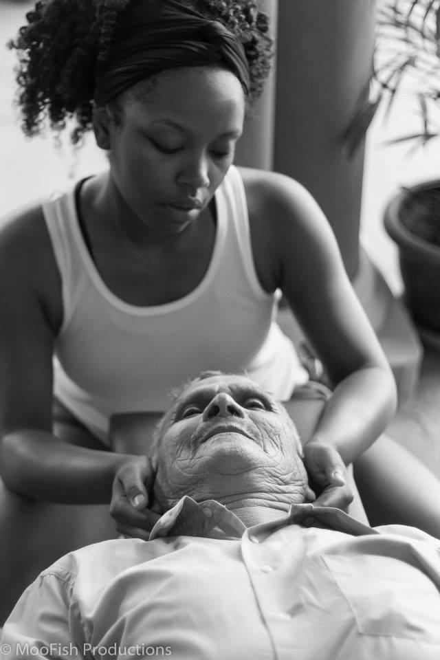 Female African-American Doctor performing a chiropractic adjustment