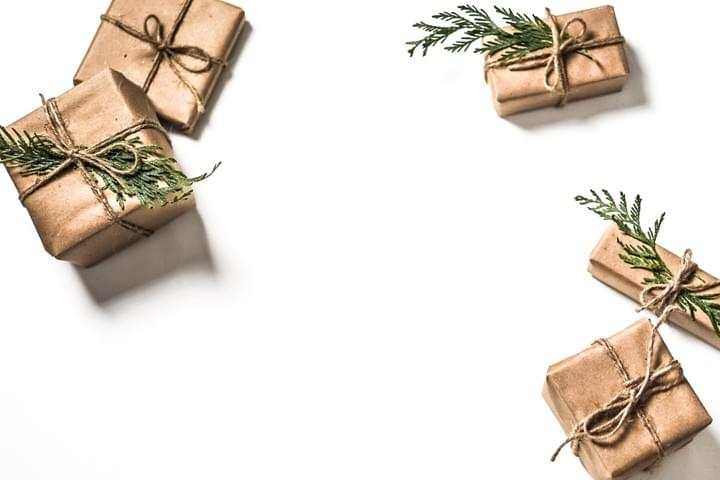Gifts wrapped in brown paper. Photo by Caley Dimmock on Unsplash