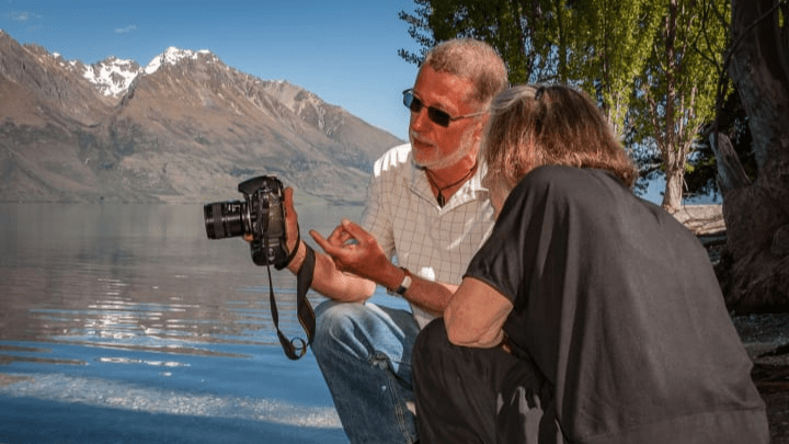 Retired television director Laurence Belcher offers guidance to a client near Glenorchy