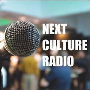 microphone on blurry background with next culture radio in white letters