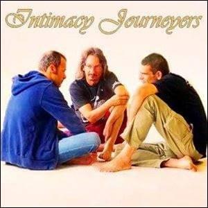 Three men sitting together on the floor being Intimacy Journeyers