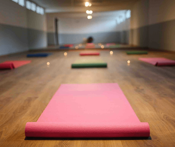 yoga mats laid out ready for an in person class.